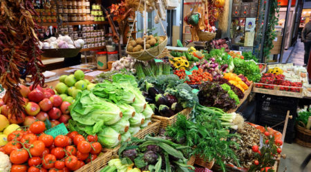 FLORENCE ITALY - APRIL 30 2015: Vegetables at Mercato Centrale market in Florence Italy. The market is an ultimate Italian shopping experience. It was opened in 1874.